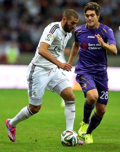 Karim Benzema e Marcos Alonso (foto AFP/Janek Skarzynski)