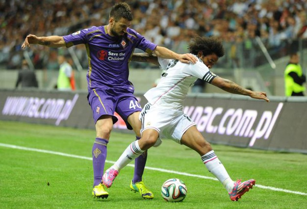 Marcelo e Nenad Tomovic (AP Photo/Alik Keplicz)