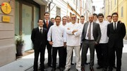 Lo staff dell'Osteria Francescana, al centro Massimo Bottura (Ansa)