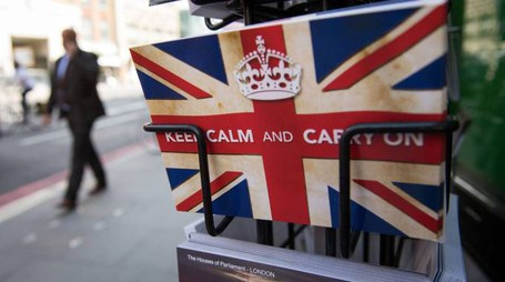 "TOPSHOT - Postcards featuring the World War II British slogan ""Keep Calm and Carry On"" are seen outside a newsagents in London, on 24 June, 2016.  Britain voted to break away from the European Union on June 24, toppling Prime Minister David Cameron and dealing a thunderous blow to the 60-year-old bloc that sent world markets plunging. / AFP PHOTO / LEON NEAL"