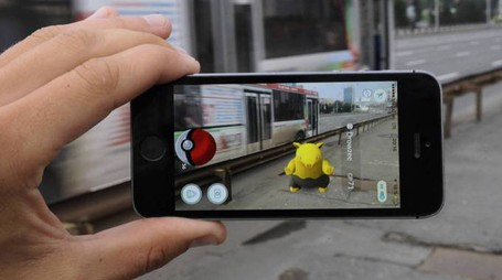 NOVOSIBIRSK, RUSSIA, JULY 19, 2016: THE POKEMON GO LOCATION BASED MOBILE GAME RUNNING ON A SMARTPHONE. THE APPLICATION, DEVELOPED BY NIANTIC, ALLOWS TO CATCH AND TRAIN POKEMONS USING A PHONE S GPS AND CAMERA. THE GAME IS AVAILABLE FOR IOS AND ANDROID DEVICES. AUGMENTED REALITY ADVENTURE, MOBILE GAME, APPLICATION, NINTENDO, IPHONE, BUS