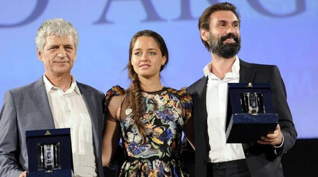 Italian actors Fabrizio Gifuni (R) and Fabrizio Bentivoglio (L), after they received  the 'Nastri d'Argento' Award (Silver Ribbon) 2014 for the Best Actor for they role in Il capitale umano, from Italian actress Matilde Gioli, during the awards ceremony in Teatro Antico, Taormina, Sicily Island, Italy, late 28 June 2014. The awards are presented annually by Sindacato Nazionale dei Giornalisti Cinematografici Italiani (SNGCI), the association of Italian film critics. ANSA/CLAUDIO ONORATI