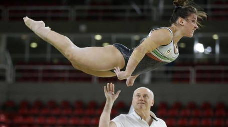 Italy's Erika Fasana is assisted by a coach during her floor routine training ahead of the 2016 Summer Olympics in Rio de Janeiro, Brazil, Thursday, Aug. 4, 2016. (ANSA/AP Photo/Julio Cortez) [CopyrightNotice: Copyright 2016 The Associated Press. All rights reserved. This material may not be published, broadcast, rewritten or redistribu]
