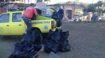 La  pulizia sulla spiaggia della Partaccia