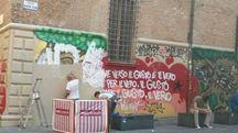 La pulitura dei murales di Palazzo Paleotti, in piazza Verdi (Foto Dire)