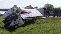 Il camion finito fuori strada in A14 (Foto Isolapress)
