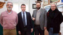 Da sinistra Roberto Zapparoli, presidente di Federconsumatori, con gli avvocati (Bp)