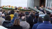 Funerali dei coniugi morti sull'A14, le bare vengono portate in chiesa fra gli applausi (foto Labolognese)