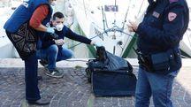 Cadavere di una donna in una valigia, il ritrovamento al porto di Rimini (Migliorini)