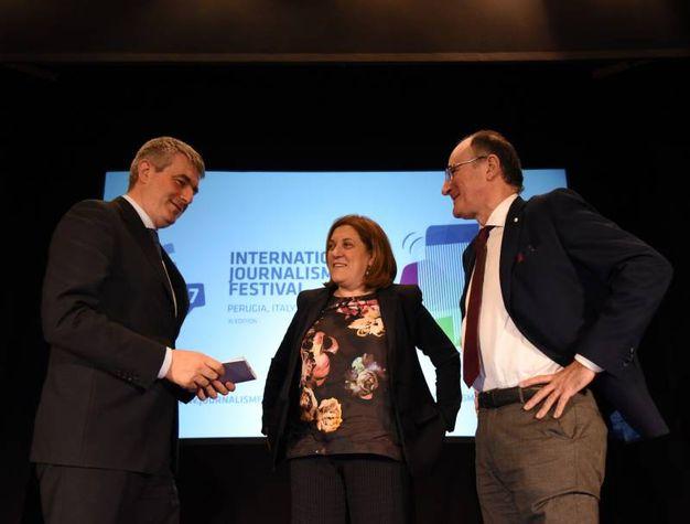 Il direttore De Robertis, il presidente Marini e il capo della redazione Umbria de La Nazione Conticelli