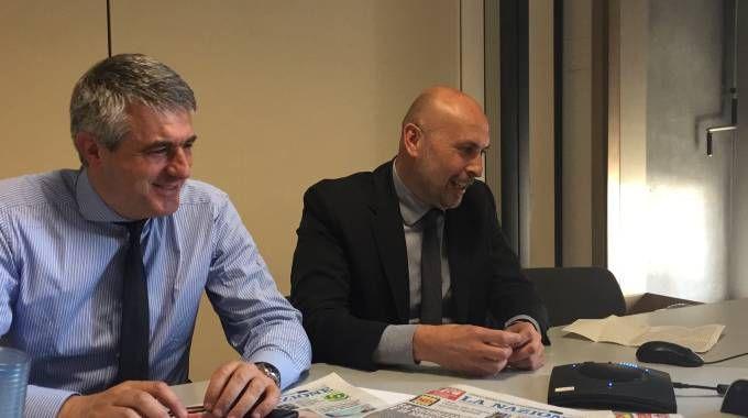 Il direttore della Nazione, De Robertis, e il sindaco Fallani durante il filo diretto