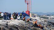 Lo scafo della barca sugli scogli del porto (Migliorini)
