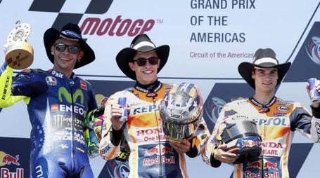 Rossi, Marquez e Pederosa sul podio di Austin (Ansa)