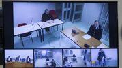 Massimo Carminati, nel riquadro grande, segue il processo di Mafia Capitale (Ansa)