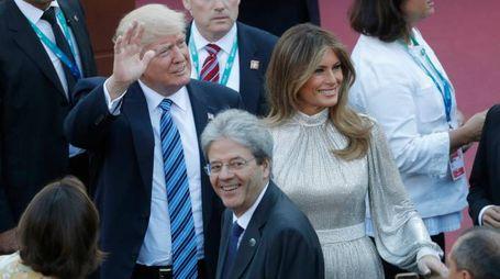 I coniugi Trump al G7 con Gentiloni (Afp)