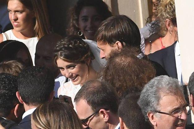 Gli sposi escono dalla chiesa (Foto Schicchi)