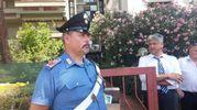 Un carabiniere di fronte all'appartamento (Foto Attalmi)
