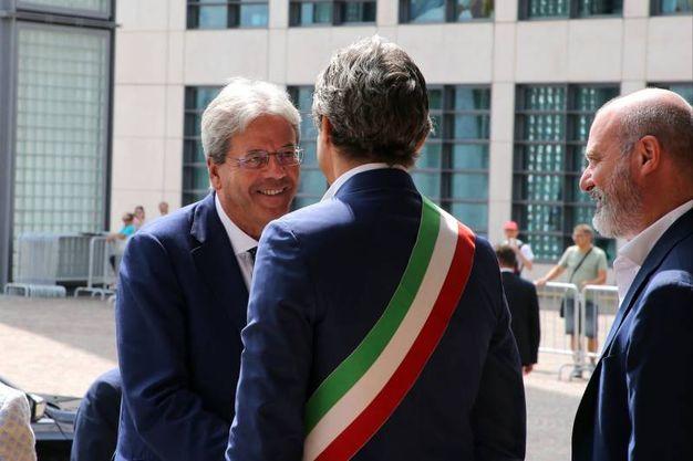 L'arrivo del premier Gentiloni al Meeting (foto LaPresse)