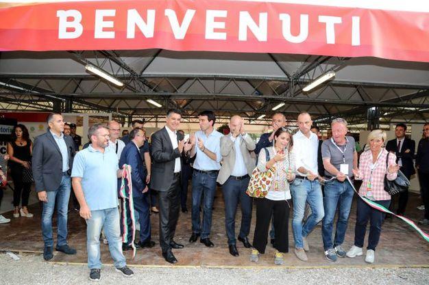 Il taglio del nastro della Festa dell'Unità di Imola col ministro Martina (Foto Isolapress)