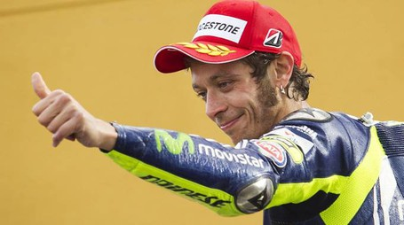Yamaha Team's Italian rider Valentino Rossi celebrates on the podium his second place at the MotoGP race of the Valencia Grand Prix at Ricardo Tormo racetrack in Cheste near Valencia on November 9, 2014. AFP PHOTO/ JAIME REINA