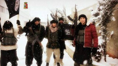 Anas El Abboub (secondo da destra) il marocchino residente nel bresciano, arrestato nel 20