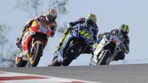 Dani Pedrosa (26), Valentino Rossi (46) e Karel Abraham (Ansa)