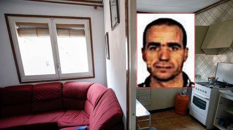 L'imam Abdelbaki Es Satty. Nello sfondo una foto del suo appartamento a Ripoll (Afp/Ansa)