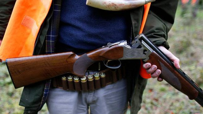 A game hunter holds his shotgun as he prepares for the hunt in a forest at Bayenghem-les-Seninghem, near Saint-Omer, northern France, November 15, 2013. Game hunting is one of the most popular pastimes in France, counting some 1.2 million people who take part in it, according to the National Federation of Hunters. Picture taken November 15, 2013.  REUTERS/Charles Platiau (FRANCE - Tags: SOCIETY ANIMALS)