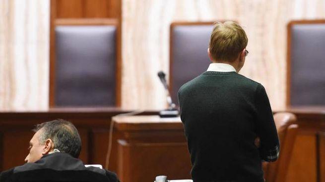 Alberto Stasi (di spalle) in aula attende la lettura della sentenza  nel processo d'appello bis per l'omicidio della fidanzata Chiara Poggi, avvenuto nel 2007 a Garlasco, Milano, 17 dicembre 2014. ANSA/DANIEL DAL ZENNARO