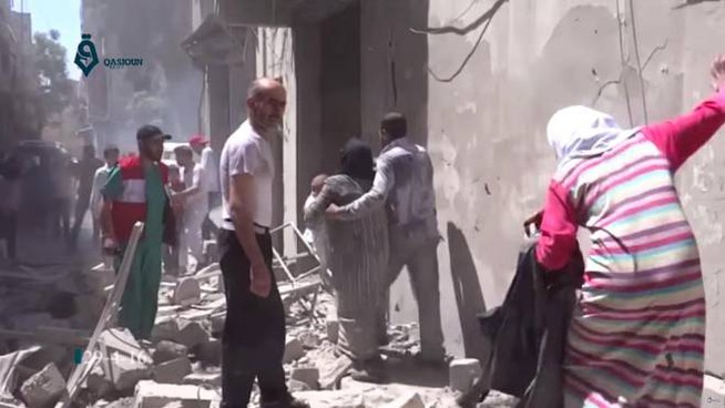 FILE - This Friday, April 29, 2016 image made from video released by Qasion News Agency, a media opposition platform that relies on a network of activists on the ground, shows people scrambling through rubble following airstrikes in Aleppo, Syria. yrian state TV says dozens of people have been killed or wounded when rebels fired rockets into a government-held neighborhood of the northern city of Aleppo. The TV says one of the rockets fired on Tuesday, May 3, 2016 hit the Dubeet hospital in the central neighborhood of Muhafaza. The TV did not give a breakdown of the casualties.  (Qasion News Agency via AP, File)