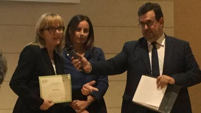 La presidente di Aset spa Lucia Capodagli mentre ritira il premio