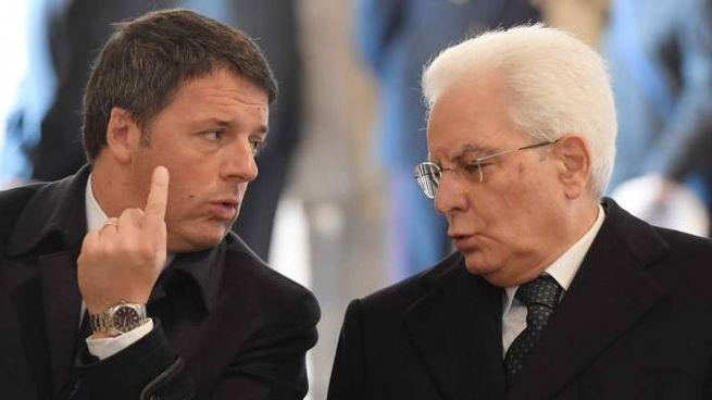 Matteo Renzi e Sergio Mattarella (Afp)