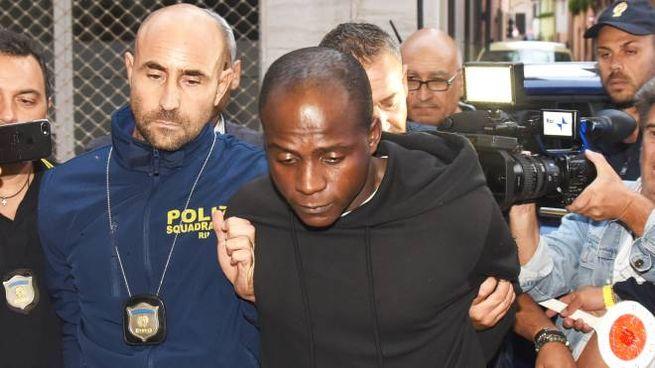 L'arresto di Guerlin Butungu, 20 anni, presunto capo branco di Rimini (foto Migliorini)