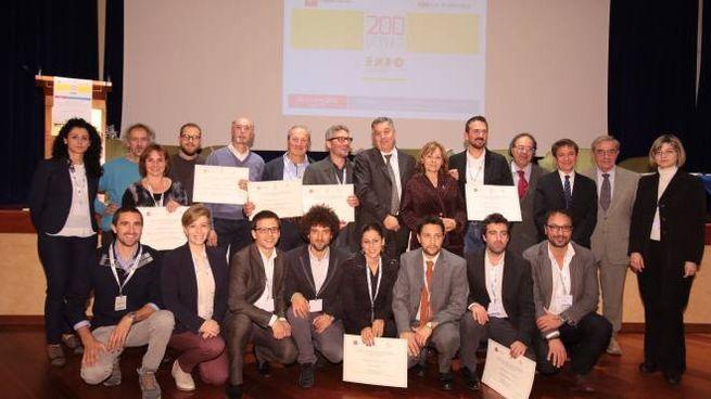 Il gruppo dei vincitori (New Press Photo)