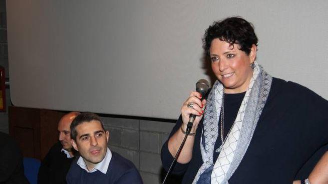 Michela Guerra con Federico Pizzarotti, sidnaco di Parma, in un incontro del 2016