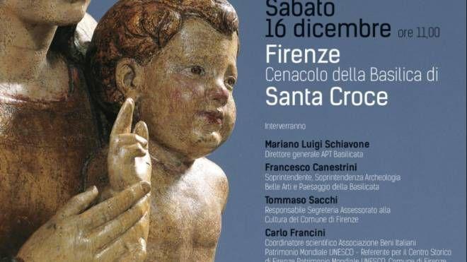 La locandina sulla mostra di statue lignee in Santa Croce