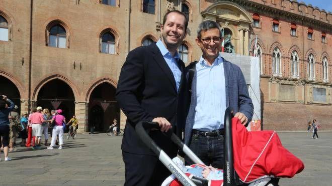 Sergio Lo Giudice in piazza Maggiore con il marito Michele Giarratano