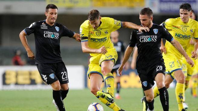 Un momento del match: si riconoscono Rigoni, Capezzi e Pasqual