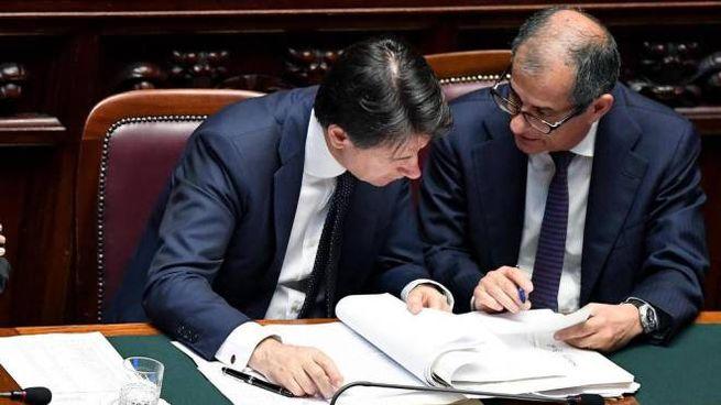 Il premier Conte con il ministro dell'Economia Giovanni Tria (Ansa)