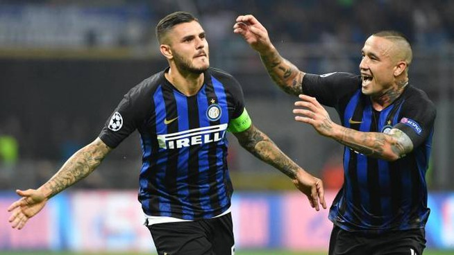 Inter Milans forward Mauro Emanuel Icardi  (L) celebrates after scoring during the UEFA Champions League group B soccer match between  Inter Milan and Tottenham Hotspur at the Giuseppe Meazza stadium in Milan, Italy, 18 September 2018. ANSA/DANIEL DAL ZENNARO