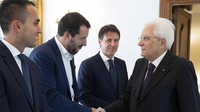 Il presidente Mattarella con Salvini, Di Maio e Conte (Ansa)