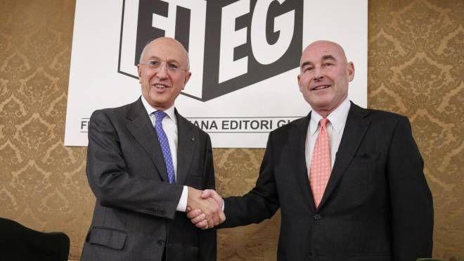 Il presidente dell'Abi Antonio Patuelli e quello della Fieg Andrea Riffeser Monti (Ansa)