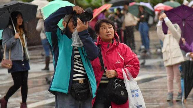 Turisti orientali  in centro