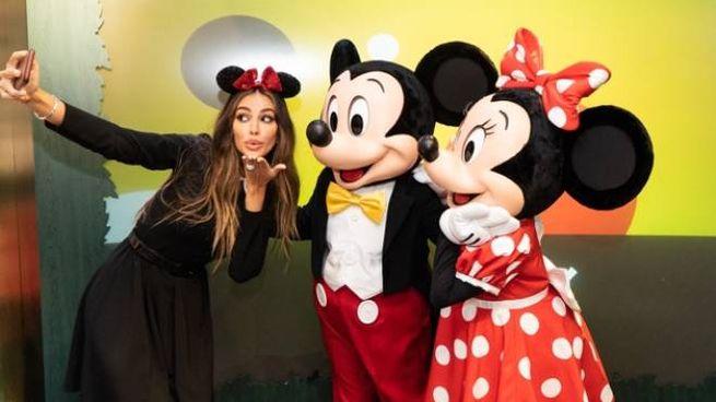Madalina Diana Ghenea with Mickey and Minnie