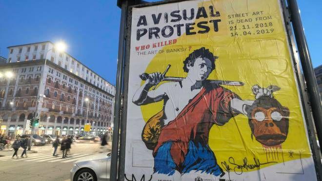 locandina di protesta contro la mostra di Banksy