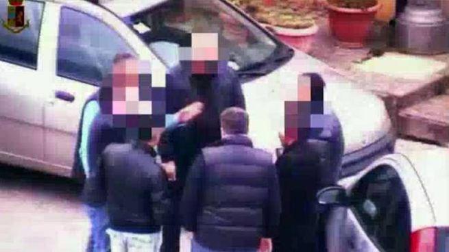 Indagine sulla 'Ndrangheta, un fermo immagine di un video della polizia (Ansa)