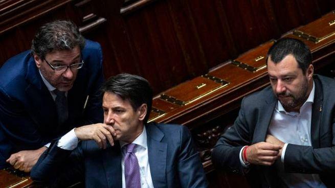 Giorgetti, Conte e Salvini (Imagoeconomica)