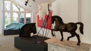 Una delle sale dell'Ippodromo Snai San Siro che ospita la mostra multimediale