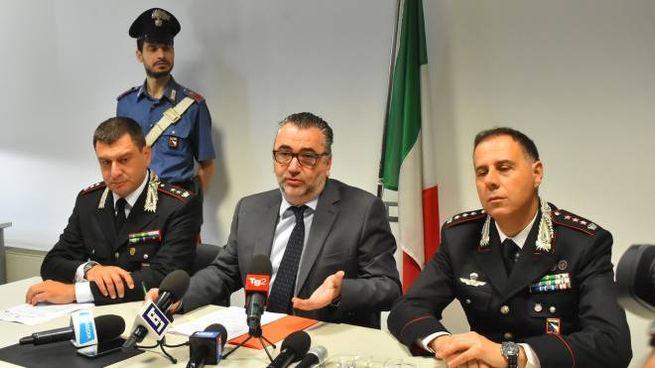 Al centro, il procuratore capo di Reggio Emilia Marco Mescolini (Foto Artioli)