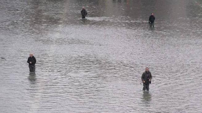 Clima, l'acqua alta a Venezia (foto Lapresse)